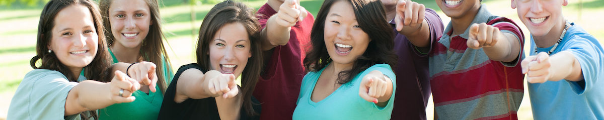 ethnic-group-of-happy-teenage-friends-outside